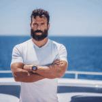dan bilzerian on a yacht in white t-shirt