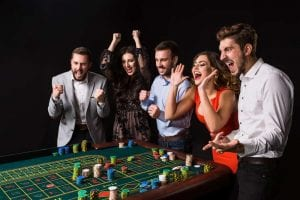 group of friends playing poker