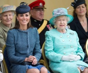 kate middleton and queen elizabeth watching a tennis match