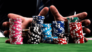 male hands holding stashes of poker chips