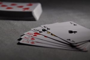 poker cards on a white table